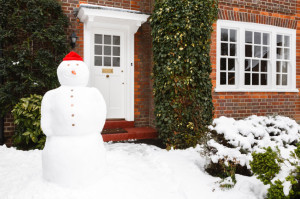 Snowman outside house